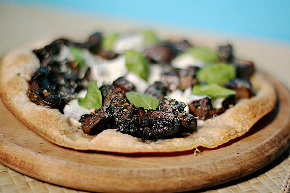 Flatbread pizza with baby portobello mushrooms and fresh herbs