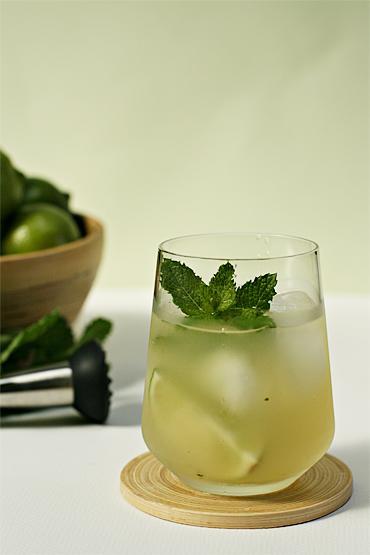 Dark rum mojito with basil