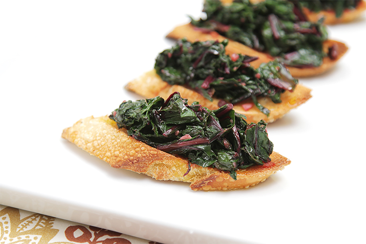 Spicy beet-green crostini