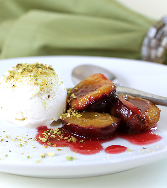 Roasted plums with Cognac and cardamom gelato