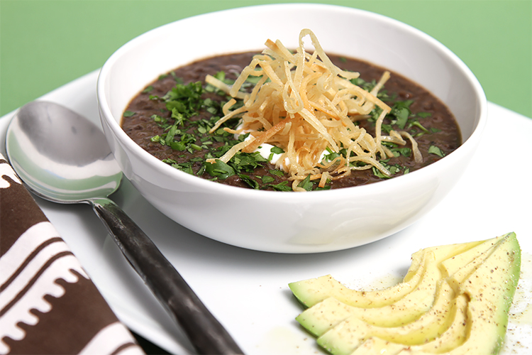 Black bean soup with pan-roasted poblano peppers and crispy shoestring tortillas-avocado slices