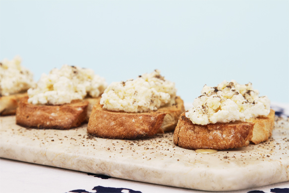 Crostini with ricotta-truffle honey and smoked salts