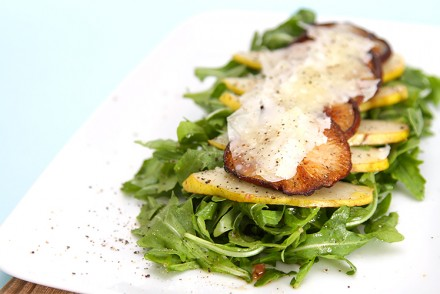 Baby arugula salad with warm shiitake mushrooms, pears, Parmesan shavings and white truffle oil