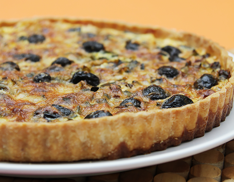 Leek tart with cured olives and aged Gruyère