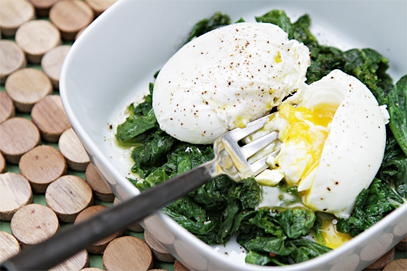 Poached eggs with sautéed greens