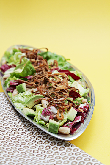 Radicchio salad with cannellini beans, avocados, fried shallots and lemon-herb vinaigrette