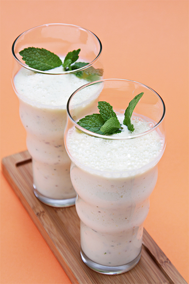 Citrus lassi with fresh mint and crushed anise seeds