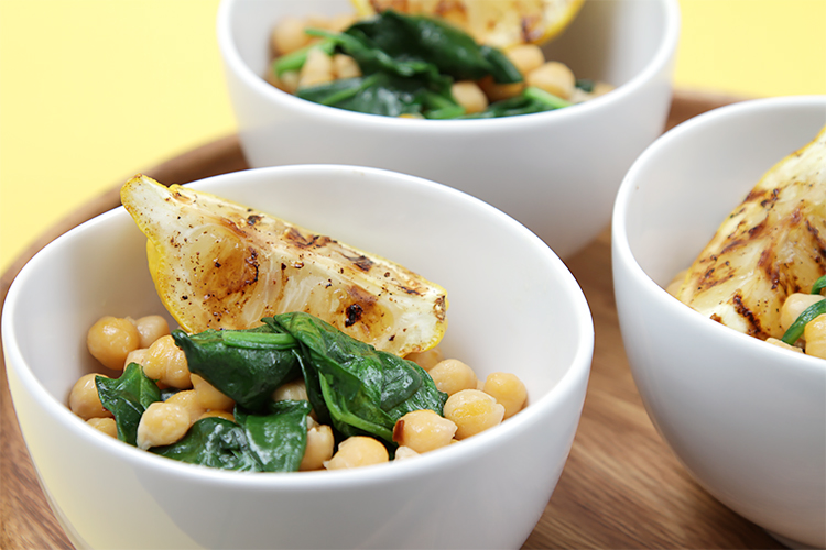 Chickpeas with wilted spinach and grilled lemons