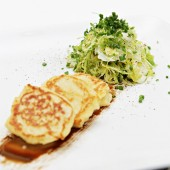 Shaved Brussels sprouts and Yukon Gold potato blinis with balsamic reduction