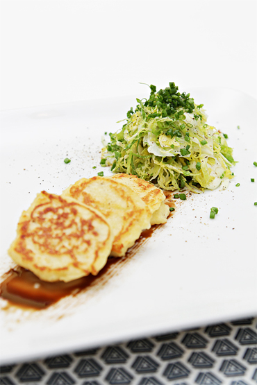Shaved Brussels sprouts and Yukon Gold potato blini with balsamic reduction