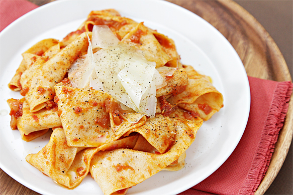 Fresh pappardelle with tomato sofrito and Manchego shavings