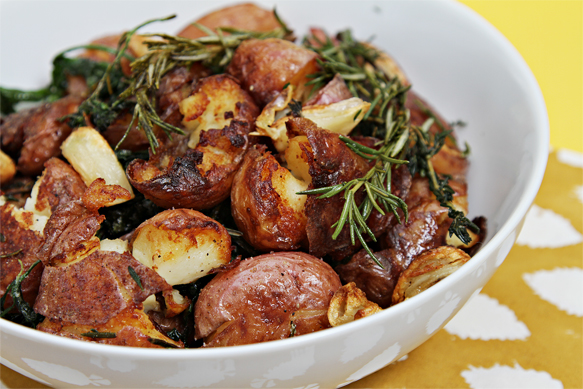 Pan-fried smashed potatoes with fresh herbs and garlic