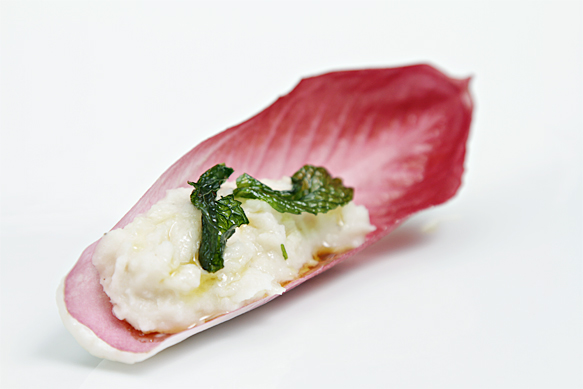 Cannellini bean dip with pan-fried mint in red endive boat