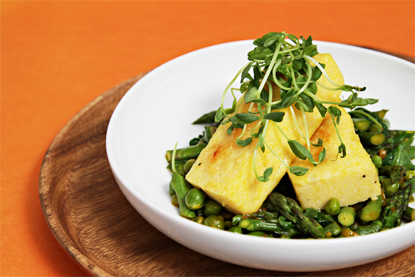 Polenta with saffron-braised sweet peas and asparagus