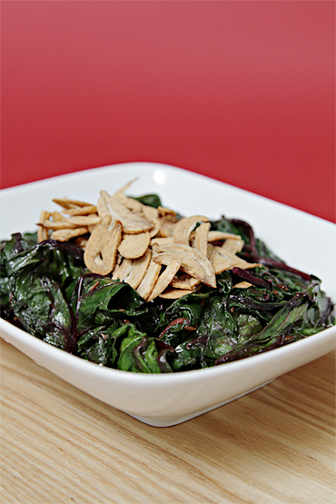 Sautéed beet greens with cumin and lemon zest-crispy fried garlic
