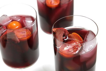 Pomegranate sangria with kumquats
