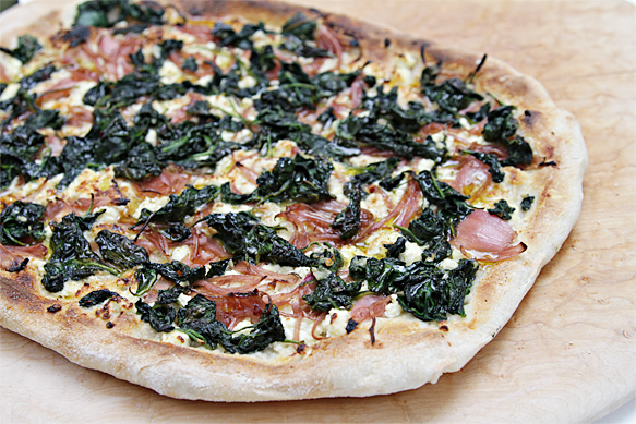 Pizza with wilted spinach and ricotta-pickled shallots