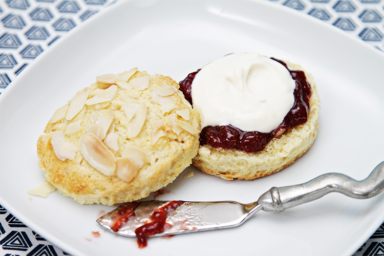Almond scones served with crème fraîche and homemade strawberry jam with balsamic