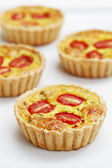 Corn tarts with smoked Gruyère and cherry tomatoes