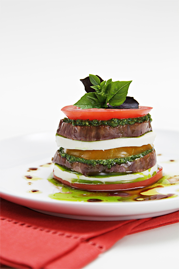 Two-color tomato napoleons with roasted eggplant and basil pesto