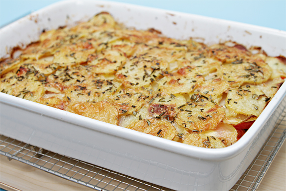 Provençal summer vegetable gratin with olives and fresh goat cheese