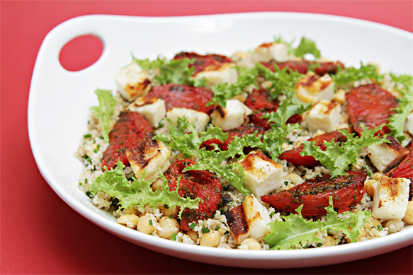 Bulgur and chickpeas with roasted tomatoes and grilled halloumi