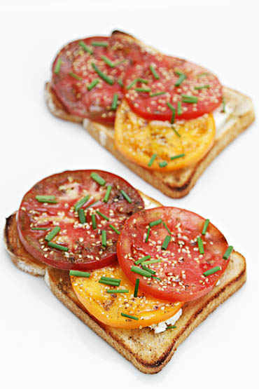 Heirloom tomato tartines with toasted sesame seeds and Sichuan peppers