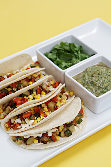 Soft tacos with red pepper and sweet corn-roasted salsa verde