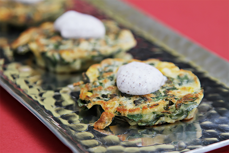 Collard greens and sweet corn buttermilk cakes with sumac-sour cream