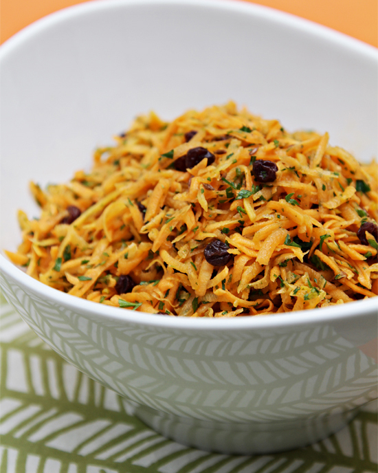 Carrot salad with currants and carrot tops