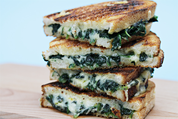 Grilled cheese sandwiches with wilted spinach and Emmental