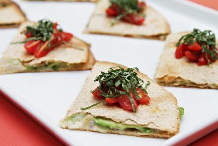 Avocado quesadillas with grape tomatoes and basil chiffonade
