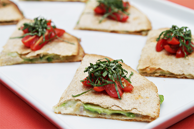 Avocado quesadillas with grape tomatoes and basil chiffonade
