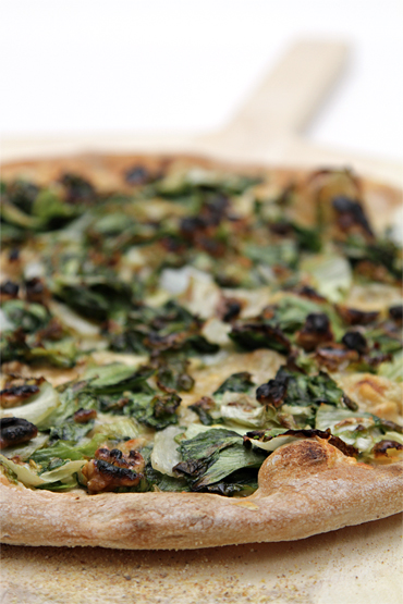 Escarole pizza with cave-aged Gruyère and walnuts
