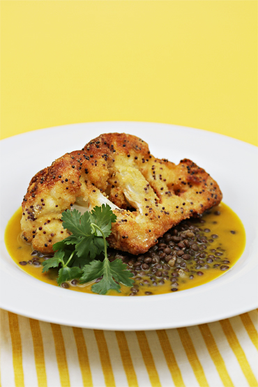 Cornmeal-crusted cauliflower wedges with Beluga lentils and curry broth
