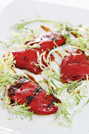 Piquillo peppers with whipped goat cheese and balsamic reduction