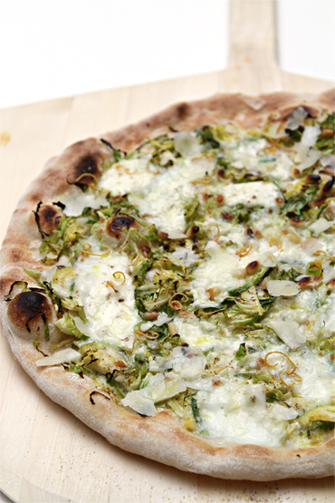 Pizza with shaved Brussels sprouts and burrata-dried lemon zest