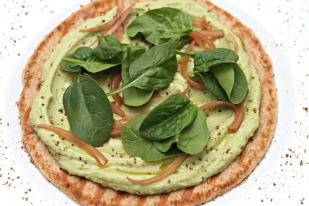 Open-face avocado hummus sandwich with pickled shallots and baby ...