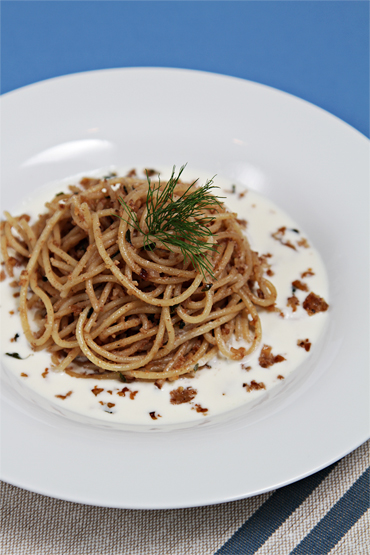 Spaghettini with walnut sauce and goat cheese fonduta