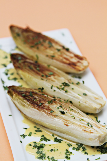 Roasted Belgian endives with citrus-pine nut vinaigrette and tarragon