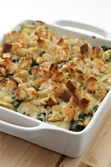 Mac & cheese with sautéed kale and fresh goat cheese-torn croutons