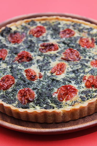 Spinach tart with sheep's milk feta and honey-roasted grape tomatoes