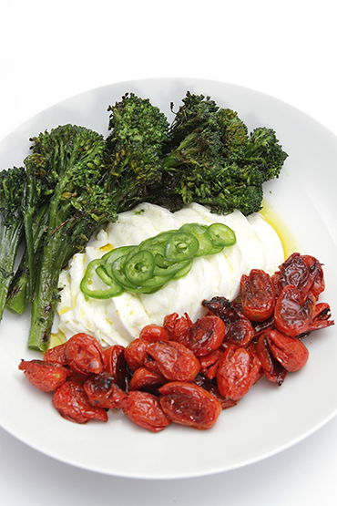Charred broccolini with buffalo mozzarella and honey-roasted grape tomatoes-shaved jalapeños