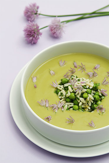 Chilled sweet pea soup with herbed-orzo salad and chive blossoms