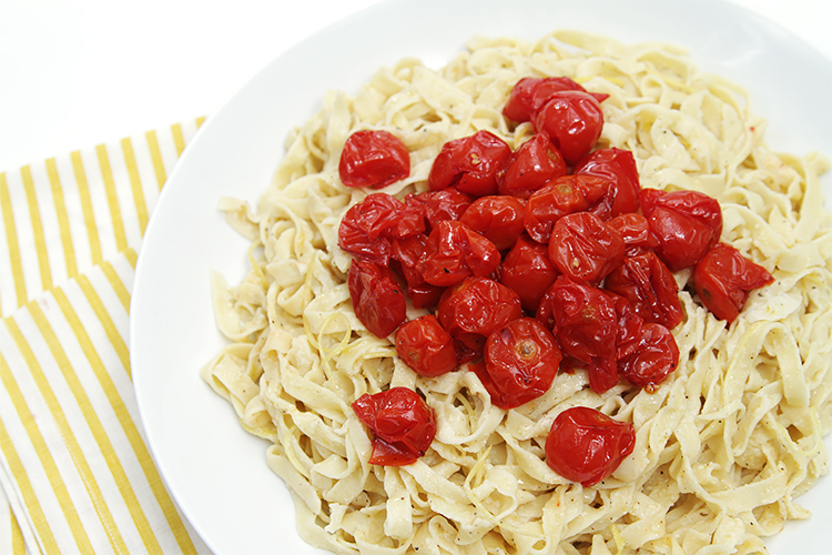 Fresh chickpea fettuccine with lemon sauce and honey-roasted cherry tomatoes