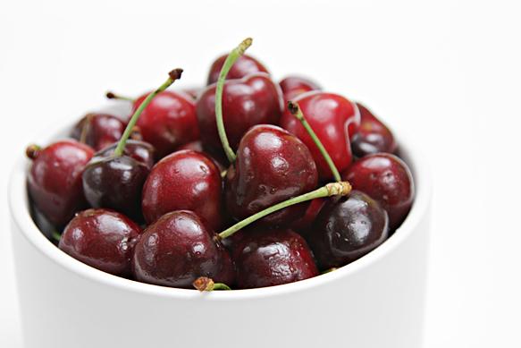 Bing cherries in white bowl
