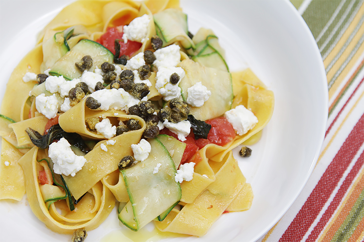 Pappardelle with zucchini ribbons, tomatoes and fried capers