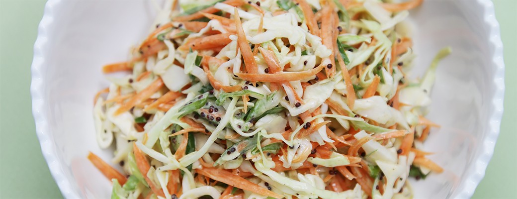 Classic coleslaw with black mustard seeds and Greek yogurt dressing