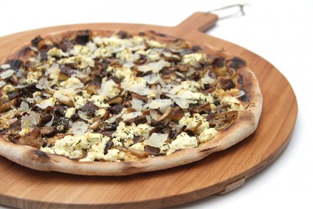Mushroom pizza with ricotta and garlic confit spread